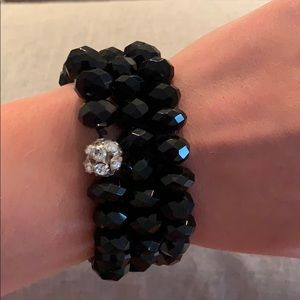 Set of 3 stretchy black bracelets with gem